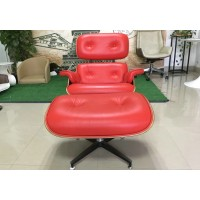 Eames style lounge chair and ottoman of tall version in red with tigerwood