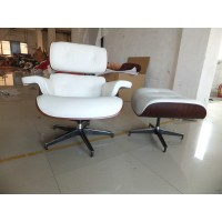 White Eames style lounge chair and ottoman in Italian leather and rosewood