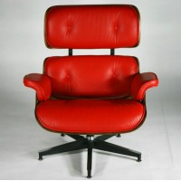 Red Eames style lounge chair and ottoman in Italian leather and Walnut plywood